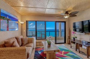 1775-Pee-Road-Poipu-Shore-202B-large-007-24-Living-Room-1500x999-72dpi